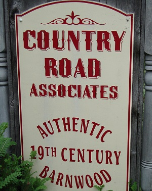 Country Road Associates Sign